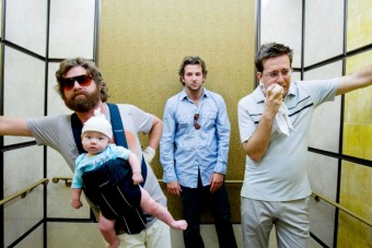 Three man and a baby in elevator