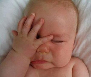 "A picture of little baby making ""facepalm"" emotion"