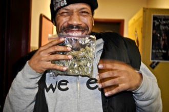 Redman holding with a smile bigbuds