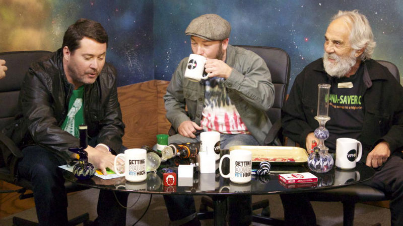 People ona table in TV show studio