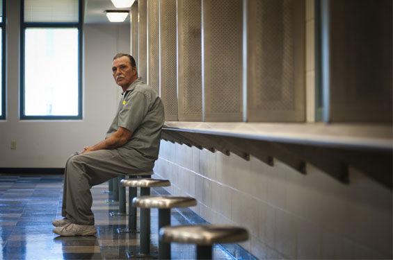 Prisoner sitting on stool in vizitation room