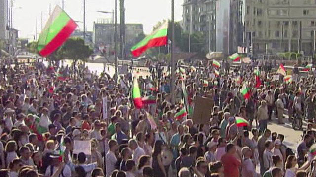 Protesters waving national flags in Sofia, Bulgaria