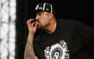 B-real smoking blunt on the stage